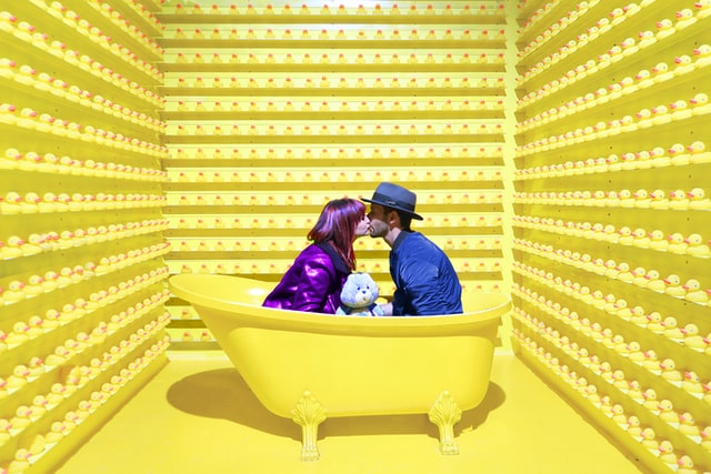 MAN AND WOMAN KISSING IN A BATHTUB
